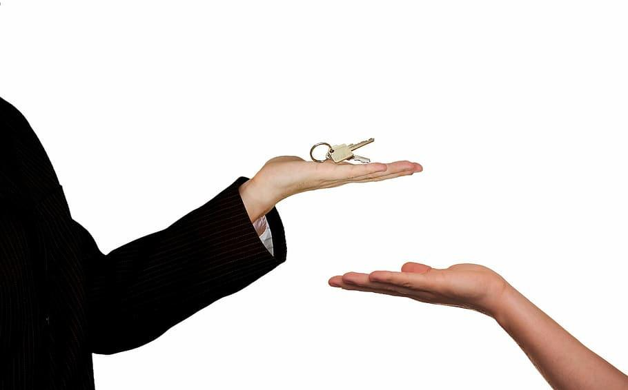 Should I Hire a Property Manager? Pros, Cons & Costs